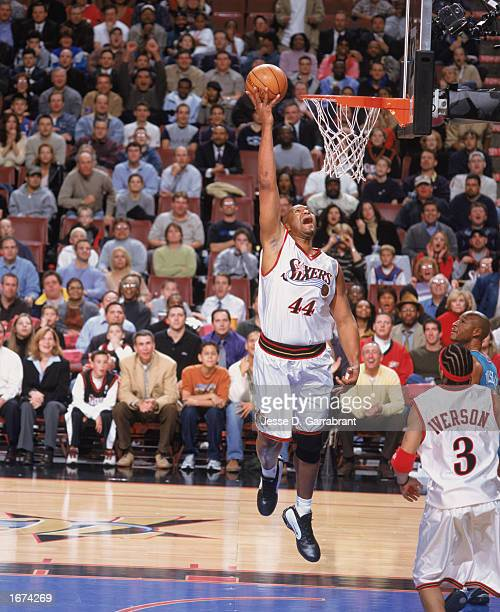 Derrick Coleman of the Philadelphia 76ers makes a dunk during the game against the New Orleans Hornets at the First Union Center on November 25, 2002...
