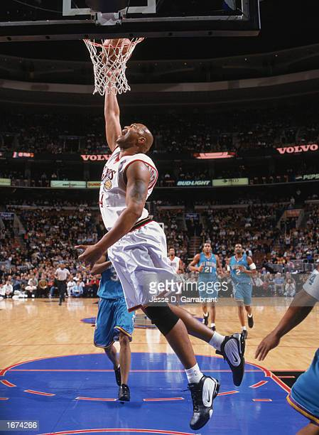 Derrick Coleman of the Philadelphia 76ers makes a layup during the game against the New Orleans Hornets at the First Union Center on November 25 2002...