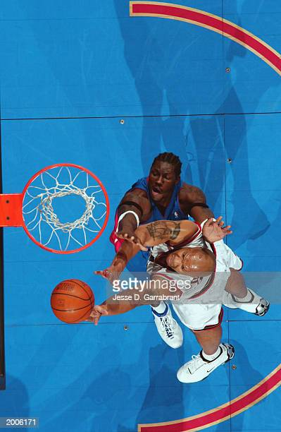 Derrick Coleman of the Philadelphia 76ers puts a shot up over Ben Wallace of the Detroit Pistons in Game four of the Eastern Conference Semifinals...