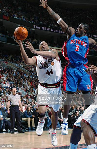 Derrick Coleman of the Philadelphia 76ers puts up a shot against Ben Wallace of the Detroit Pistons in Game six of the Eastern Conference Semifinals...