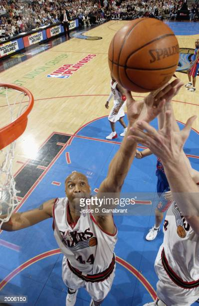 Derrick Coleman of the Philadelphia 76ers reaches for a rebound in Game four of the Eastern Conference Semifinals during the 2003 NBA Playoffs...