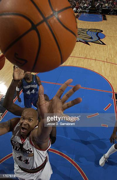 Derrick Coleman of the Philadelphia 76ers reaches for the rebound during the NBA game against the Minnesota Timberwolves at First Union Center on...
