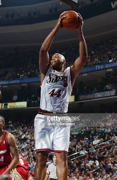 Derrick Coleman of the Philadelphia 76ers rebounds against the Cleveland Cavaliers during the game at the Wachovia Center on December 19 2003 in...