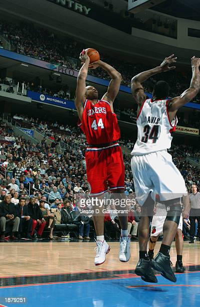 Derrick Coleman of the Philadelphia 76ers shoots a jump shot over Dale Davis of the Portland Trail Blazers during the game at First Union Center on...