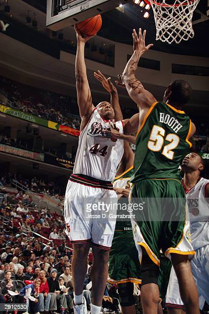 Derrick Coleman of the Philadelphia 76ers shoots against Calvin Booth of the Seattle Sonics during the game at Wachovia Center on January 19, 2004 in...