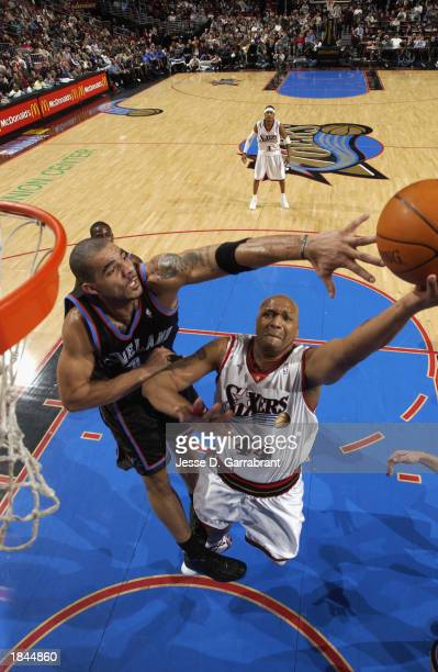 Derrick Coleman of the Philadelphia 76ers shoots against Carlos Boozer of the Cleveland Cavaliers during the game at First Union Center on February...