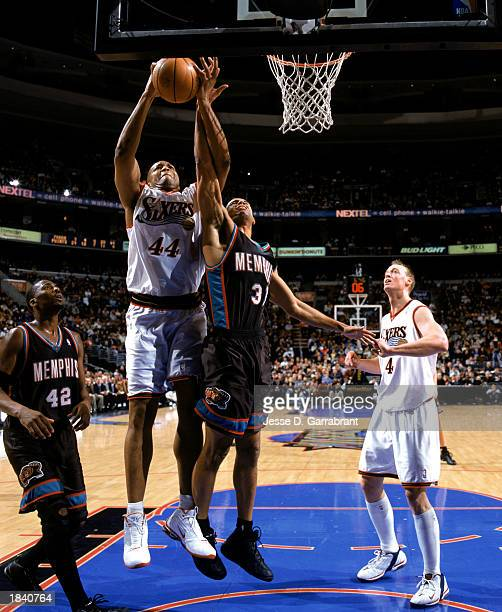 Derrick Coleman of the Philadelphia 76ers takes the ball up against Shane Battier of the Memphis Grizzlies during the game at First Union Center on...