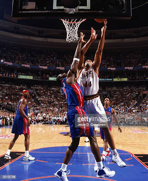 Derrick Coleman of the Philadelphia 76ers takes the shot against Ben Wallace Detroit Pistons in Game four of the Eastern Conference Semifinals during...