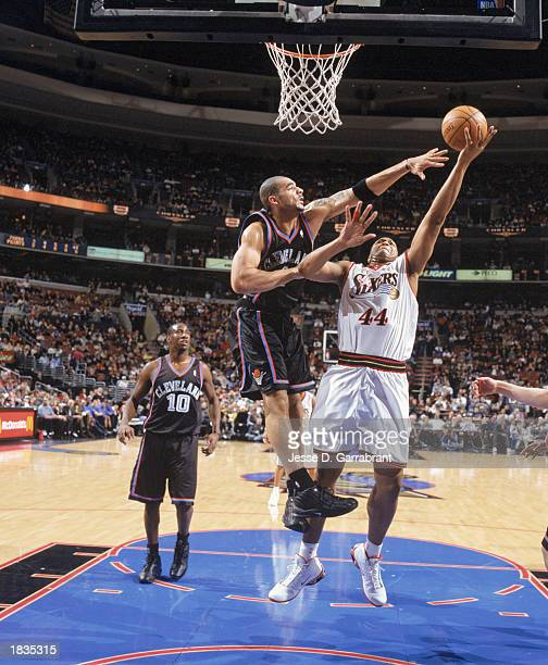 Derrick Coleman of the Philadelphia 76ers takes the shot against Carlos Boozer of the Cleveland Cavaliers during the game at First Union Center on...