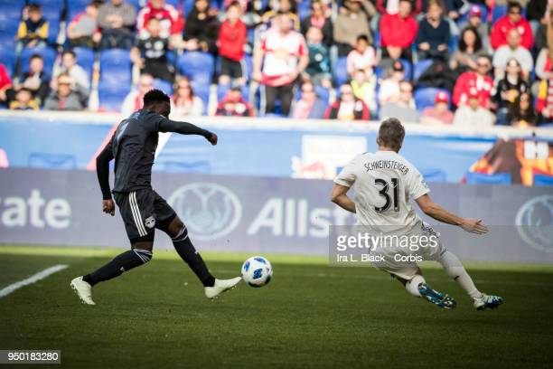 Derrick Etienne of New York Red Bulls tries for the shot on goal against Bastian Schweinsteiger of Chicago Fire during the Major League Soccer match...