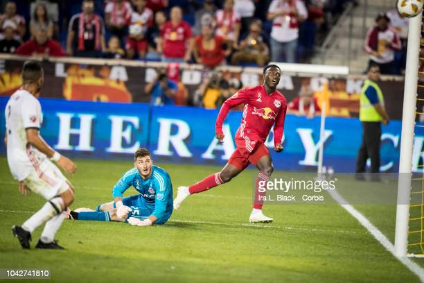 Derrick Etienne of New York Red Bulls watches the ball go past Alex Bono of Toronto FC for a goal during the 2nd half of the Major League Soccer...