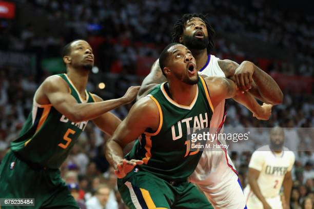 Derrick Favors and Rodney Hood of the Utah Jazz box out DeAndre Jordan of the Los Angeles Clippers during the first half of Game Seven of the Western...