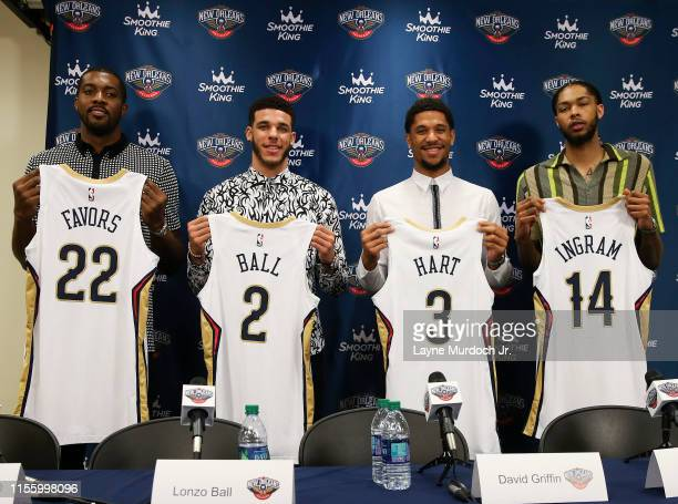 Derrick Favors Lonzo Ball Josh Hart and Brandon Ingram of the New Orleans Pelicans pose for a photo at the introductory press conference on July 16...