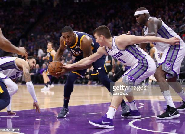 Derrick Favors of the Utah Jazz and Bogdan Bogdanovic of the Sacramento Kings go for the ball at Golden 1 Center on January 17 2018 in Sacramento...