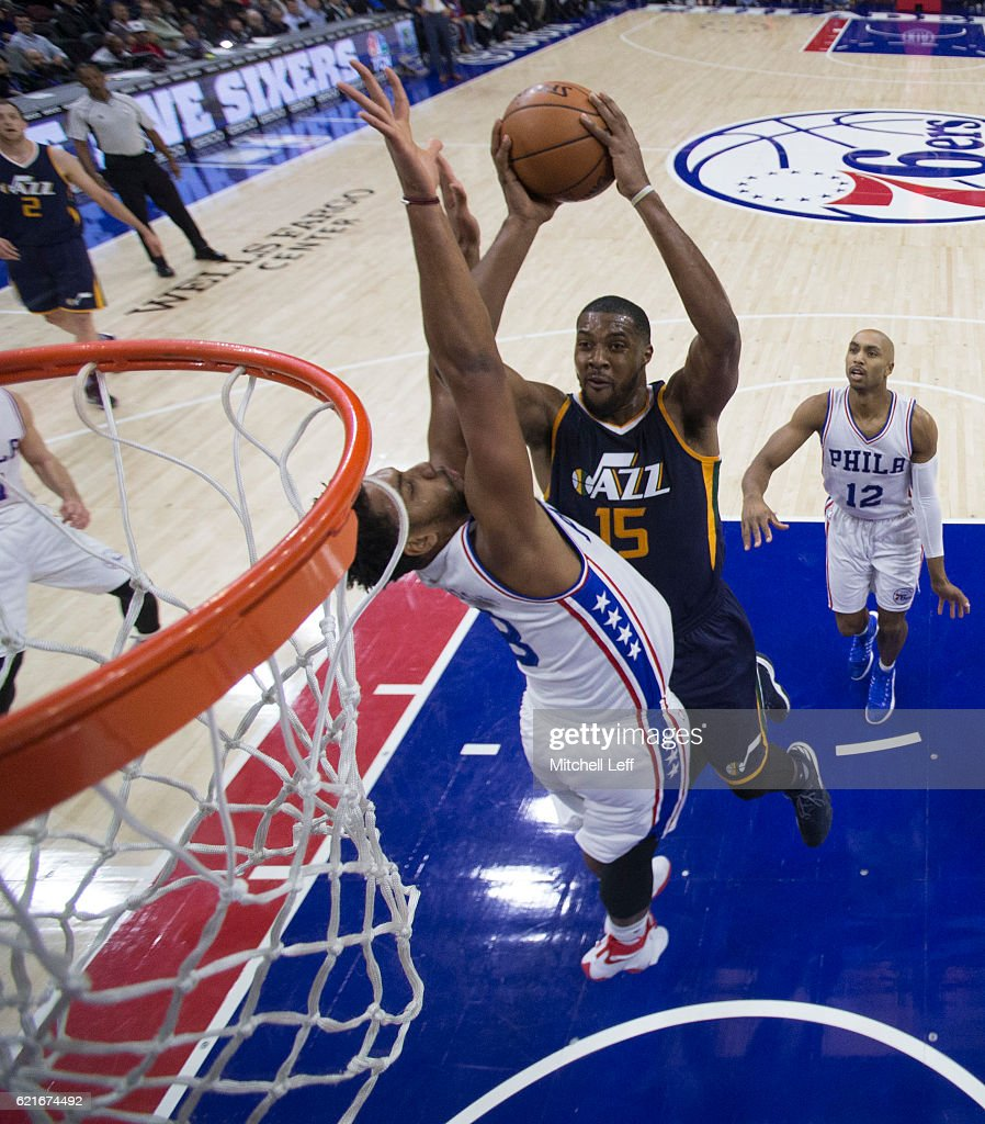 Derrick Favors #15 of the Utah Jazz attempts a shot against Jahlil Okafor #8 of the Philadelphia 76ers in the first half at Wells Fargo Center on November 7, 2016 in Philadelphia, Pennsylvania. The Jazz defeated the 76ers 109-84.