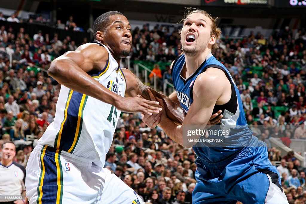 Derrick Favors #15 of the Utah Jazz battles for rebound position against Lou Amundson #17 of the Minnesota Timberwolves at Energy Solutions Arena on January 2, 2013 in Salt Lake City, Utah.