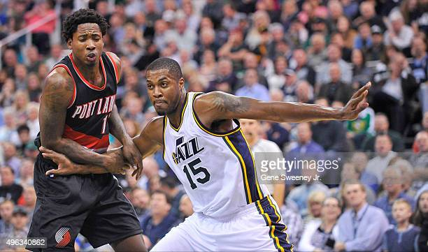 Derrick Favors of the Utah Jazz blocks Ed Davis of the Portland Trail Blazers at Vivint Smart Home Arena on November 4 2015 in Salt Lake City Utah...