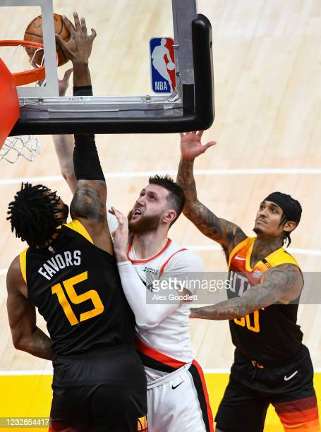 Derrick Favors of the Utah Jazz blocks Jusuf Nurkic of the Portland Trail Blazers during a game at Vivint Smart Home Arena on May 12, 2021 in Salt...
