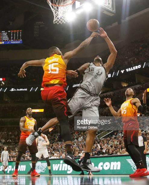 Derrick Favors of the Utah jazz blocks shot of LaMarcus Aldridge of the San Antonio Spurs at ATT Center on March 23 2018 in San Antonio Texas NOTE TO...