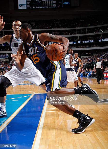 Derrick Favors of the Utah Jazz drives baseline against Yi Jianlian of the Dallas Mavericks on March 3 2012 at the American Airlines Center in Dallas...