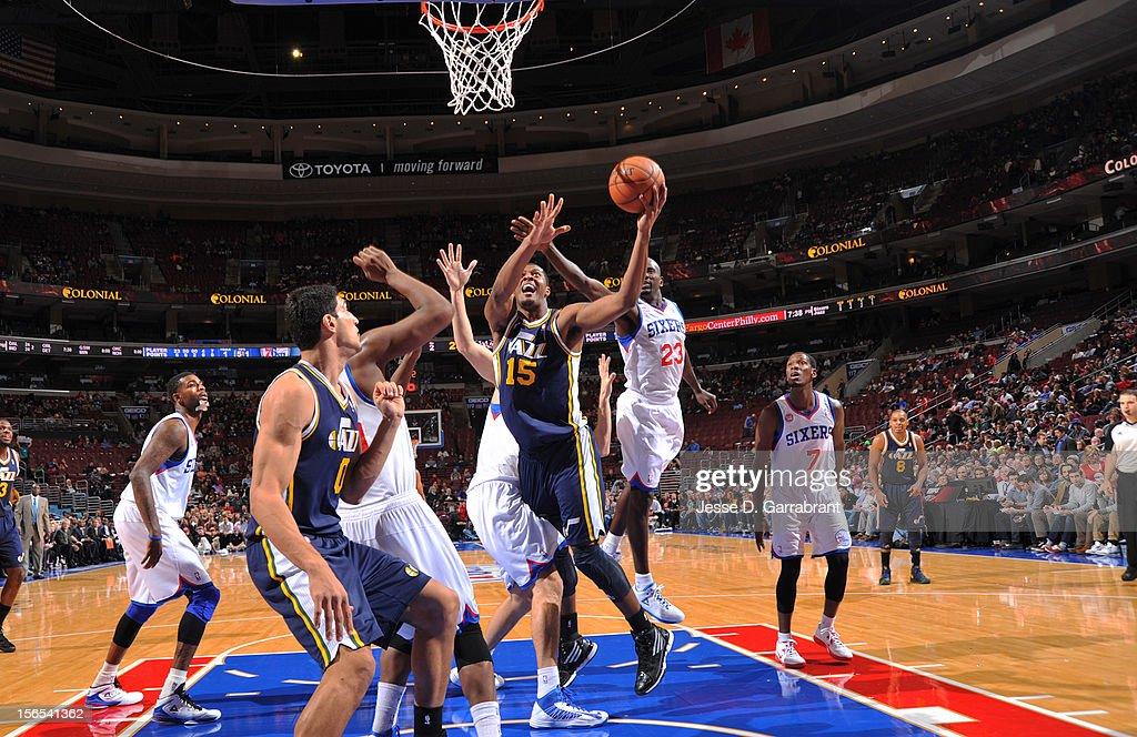 Derrick Favors #15 of the Utah Jazz drives to the basket against the Philadelphia 76ers at the Wells Fargo Center on November 16, 2012 in Philadelphia, Pennsylvania.