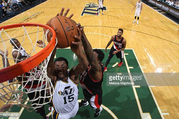 Derrick Favors of the Utah Jazz dunks against Ed Davis of the Portland Trail Blazers during a preseason game at EnergySolutions Arena on October 12...