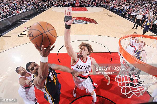 Derrick Favors of the Utah Jazz goes for the layup against Robin Lopez of the Portland Trail Blazersduring the game on February 3 2015 at Moda...