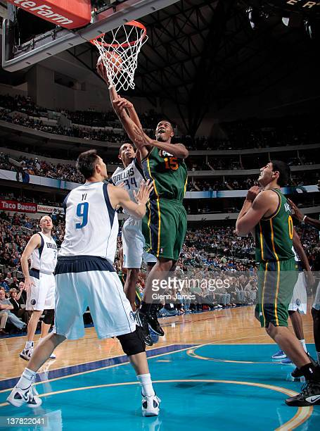 Derrick Favors of the Utah Jazz goes in for the layup against Yi Jianlian of the Dallas Mavericks on January 27 2012 at the American Airlines Center...