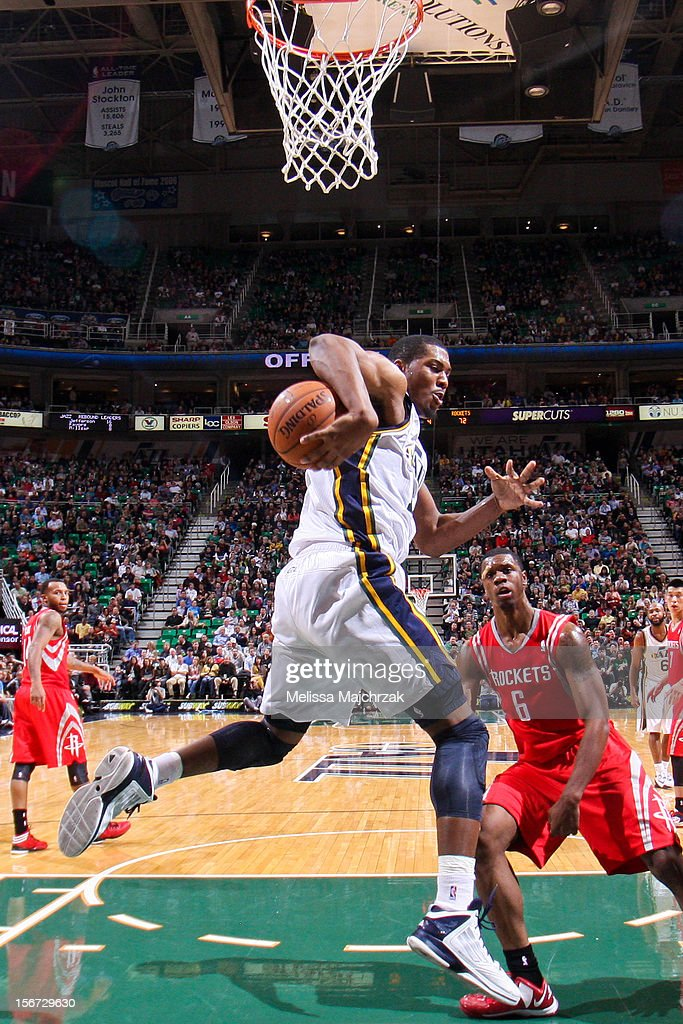Derrick Favors #15 of the Utah Jazz grabs a rebound against Terrence Jones #6 of the Houston Rockets at Energy Solutions Arena on November 19, 2012 in Salt Lake City, Utah.