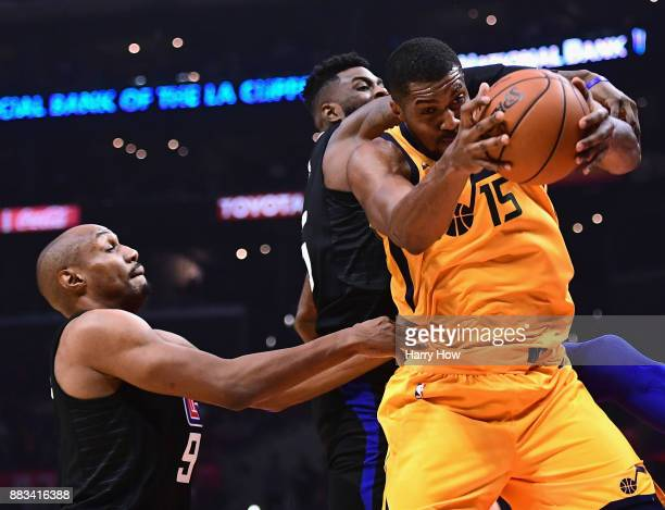 Derrick Favors of the Utah Jazz grabs a rebound from Willie Reed and CJ Williams of the LA Clippers during a 126107 win over the LA Clippers at...