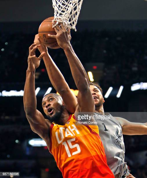 Derrick Favors of the Utah jazz grabs a rebound in front of Kyle Anderson of the San Antonio Spurs at ATT Center on March 23 2018 in San Antonio...