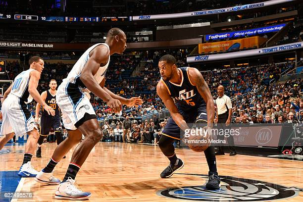 Derrick Favors of the Utah Jazz handles the ball against Bismack Biyombo of the Orlando Magic during a game on November 11 2016 at the Amway Center...