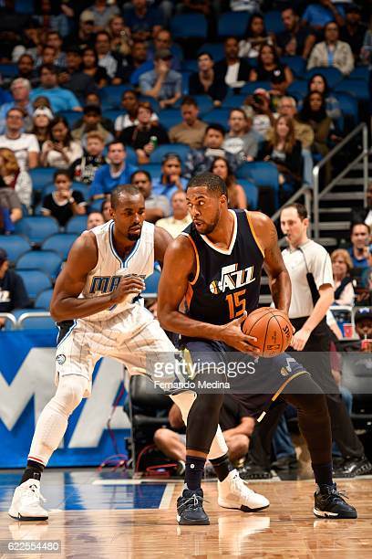 Derrick Favors of the Utah Jazz handles the ball against Serge Ibaka of the Orlando Magic during a game on November 11 2016 at the Amway Center in...