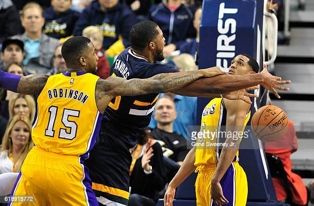 Derrick Favors of the Utah Jazz is fouled by Thomas Robinson of the Los Angeles Lakers in the first half at Vivint Smart Home Arena on October 28...