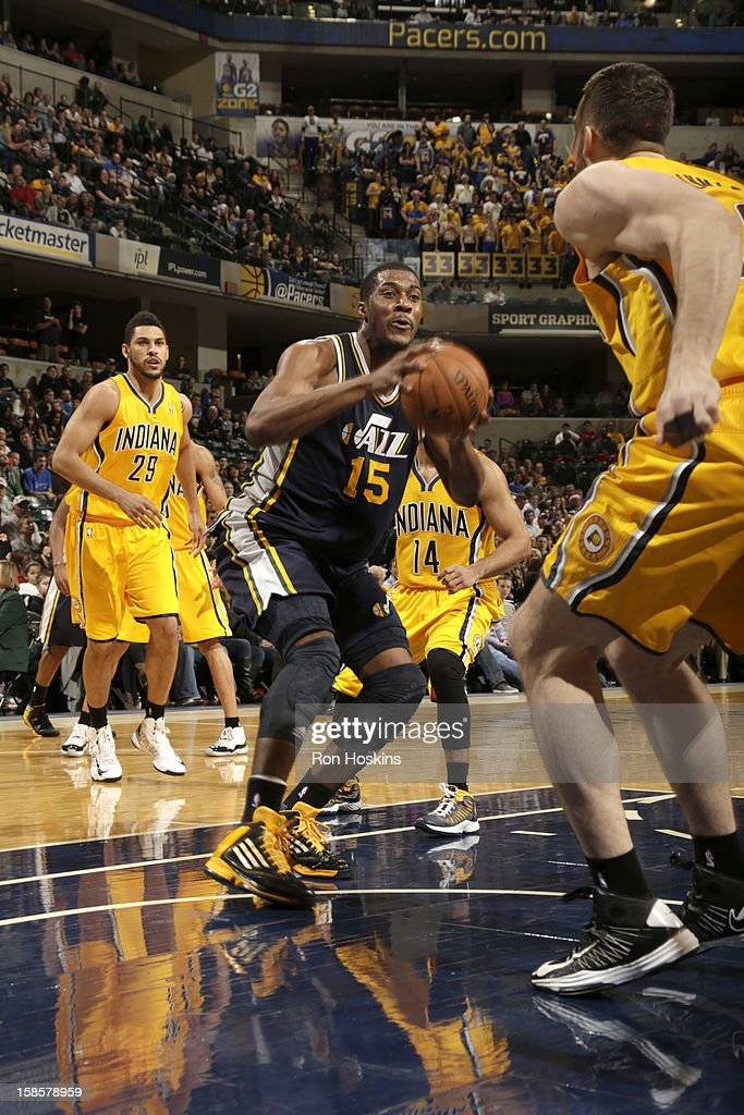 Derrick Favors #15 of the Utah Jazz looks to pass the ball during the game between the Indiana Pacers and the Utah Jazz on December 19, 2012 at Bankers Life Fieldhouse in Indianapolis, Indiana.