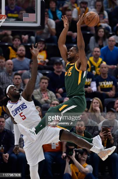 Derrick Favors of the Utah Jazz misses a pass while being defended by Montrezl Harrell of the LA Clippers in the first half of a NBA game at Vivint...