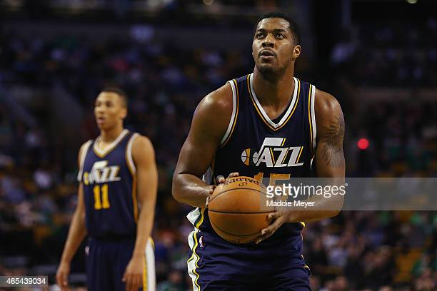 Derrick Favors of the Utah Jazz shoots a free throw against the Boston Celtics at TD Garden on March 4 2015 in Boston Massachusetts The Celtics...