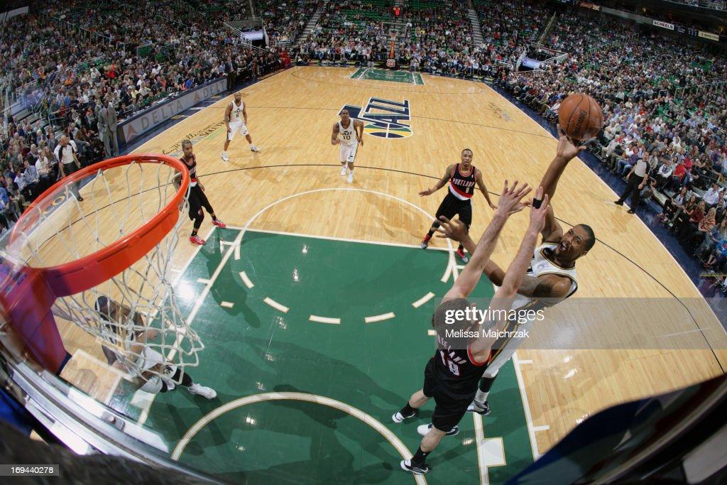 Derrick Favors #15 of the Utah Jazz shoots against Joel Freeland #19 of the Portland Trail Blazers at Energy Solutions Arena on April 1, 2013 in Salt Lake City, Utah.