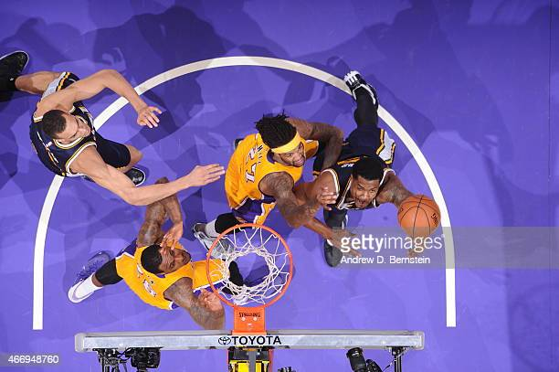 Derrick Favors of the Utah Jazz shoots against Jordan Hill of the Los Angeles Lakers on March 19 2015 at STAPLES Center in Los Angeles California...