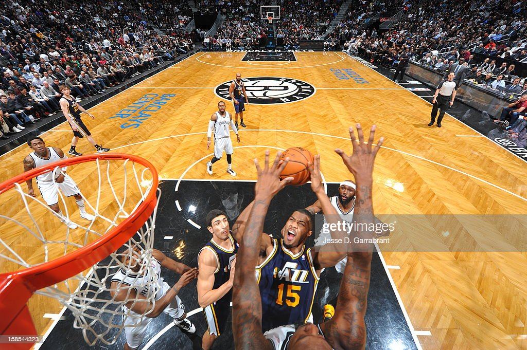 Derrick Favors #15 of the Utah Jazz shoots against the Brooklyn Nets during the game at the Barclays Center on December 18, 2012 in Brooklyn, New York.