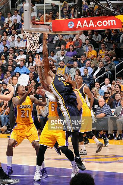 Derrick Favors of the Utah Jazz shoots against the Los Angeles Lakers on March 19 2015 at STAPLES Center in Los Angeles California NOTE TO USER User...