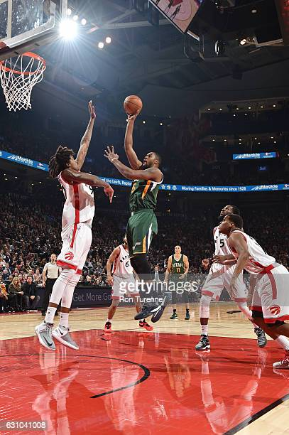 Derrick Favors of the Utah Jazz shoots the ball against Lucas Nogueira of the Toronto Raptors during the game on January 5 2017 at the Air Canada...