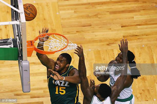 Derrick Favors of the Utah Jazz takes a shot with pressure from Jae Crowder of the Boston Celtics and Amir Johnson during the first quarter at TD...