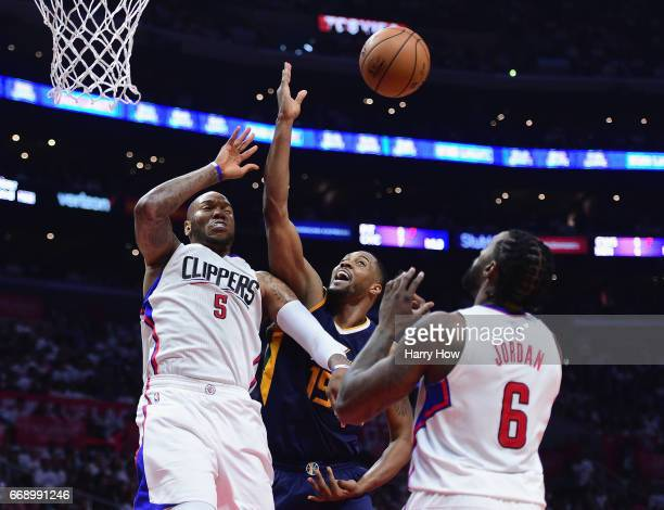 Derrick Favors of the Utah Jazz tries for a rebound between Marreese Speights and DeAndre Jordan of the LA Clippers during a 9795 Jazz win at Staples...
