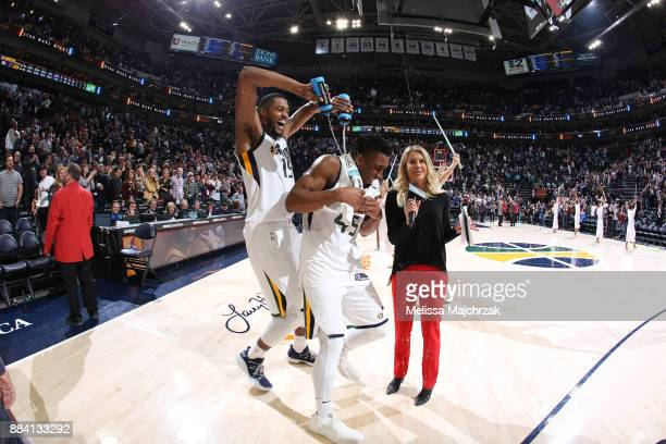 Derrick Favors pours water on Donovan Mitchell of the Utah Jazz after the game against the New Orleans Pelicans on December 1 2017 at vivintSmartHome...