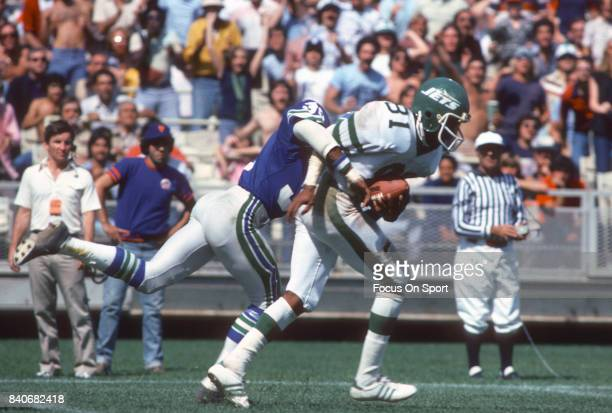 Derrick Gaffney of the New York Jets fights to break away from Connell Webster of the Seattle Seahawks during an NFL football game September 17 1978...