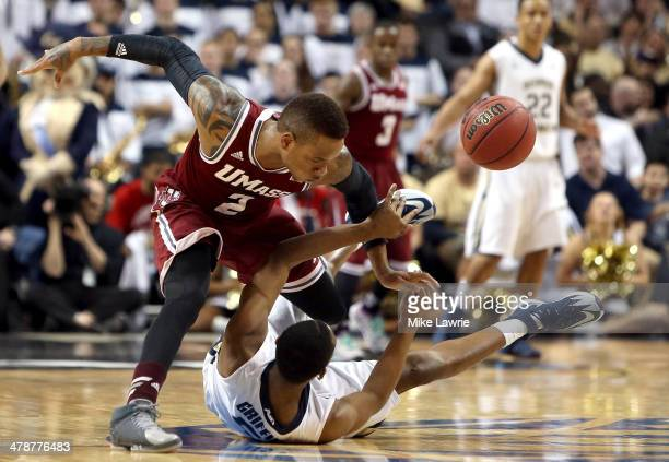Derrick Gordon of the Massachusetts Minutemen goes for a loose ball against Nick Griffin of the George Washington Colonials in the second half during...
