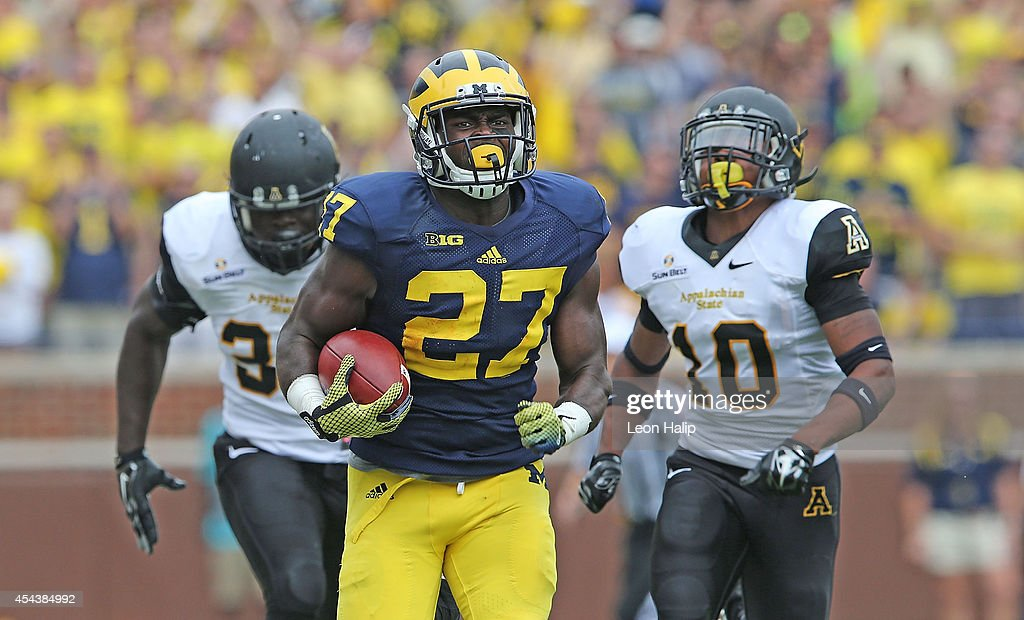Derrick Green #27 of the Michigan Wolverines runs for a long gain during the second half of the game against Appalachian State at Michigan Stadium on August 30, 2014 in Ann Arbor, Michigan. The Wolverines defeated the Mountaineers 52-14.