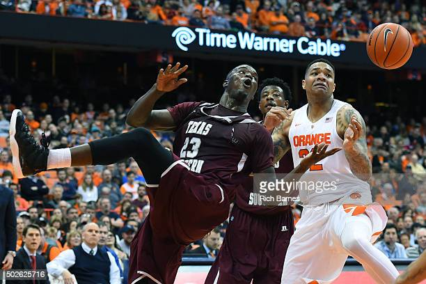 Derrick Griffin of the Texas Southern Tigers and DaJuan Coleman of the Syracuse Orange react to a loose ball during the second half at the Carrier...