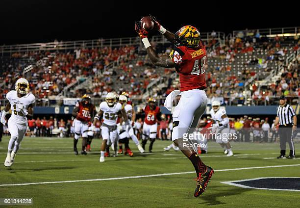 Derrick Hayward of the Maryland Terrapins scores a touchdown during the first half of the game against the FIU Panthers at FIU Stadium on September 9...